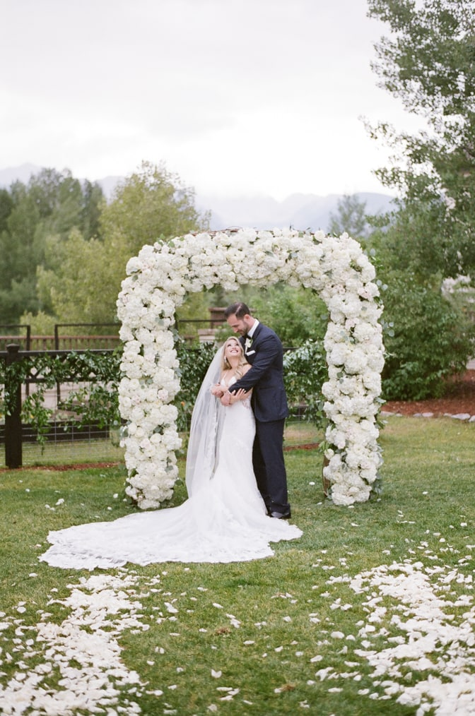 Bride and groom embracing each other on their Vail wedding day at Larkspur events and dining