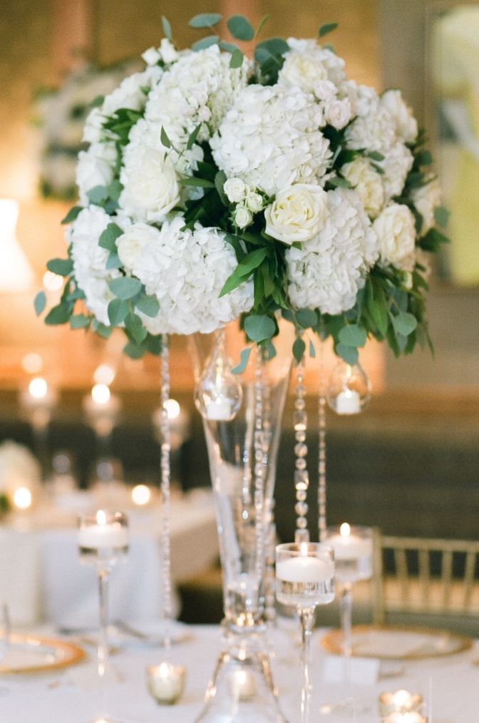 Tall white floral centerpiece at Larkspur events and dining in Vail
