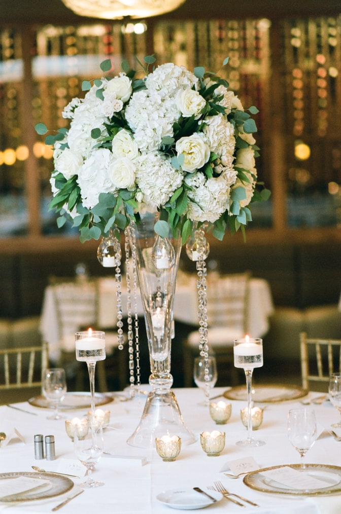 White floral centerpiece at Larkspur events and dining wedding in Vail
