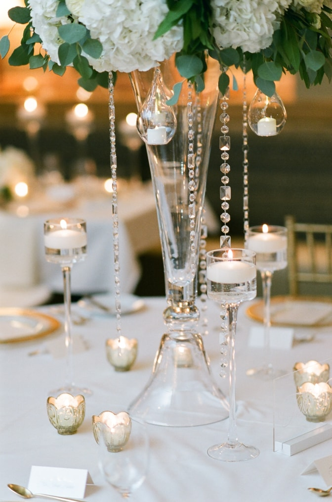 Crystal beads hanging from tall centerpiece at Larkspur events and dining wedding in Vail