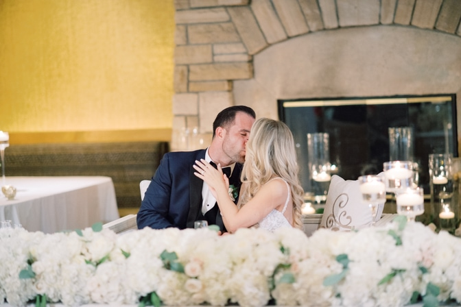 Bride and groom kissing during Larkspur events and dining wedding reception in Vail
