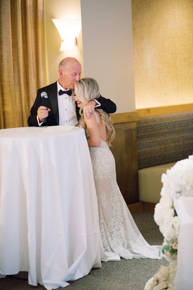 Father of bride kissing the bride during wedding speech at Larkspur events and dining in Vail