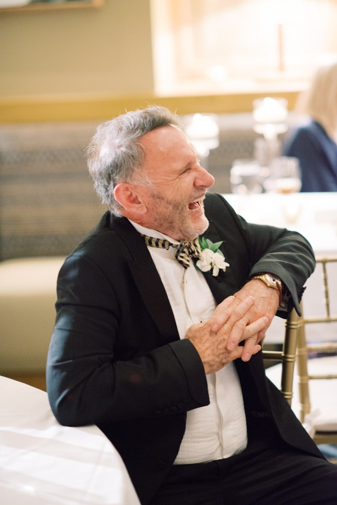 Father of groom laughing during speeches at Larkspur events and dining in Vail
