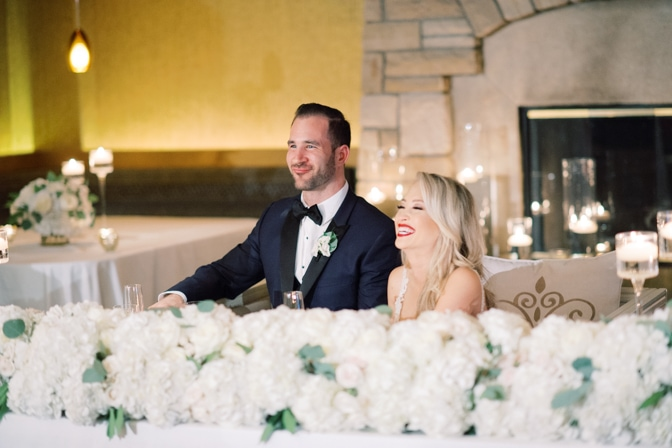 Bride and groom laughing during wedding speeches at Larkspur events and dining in Vail