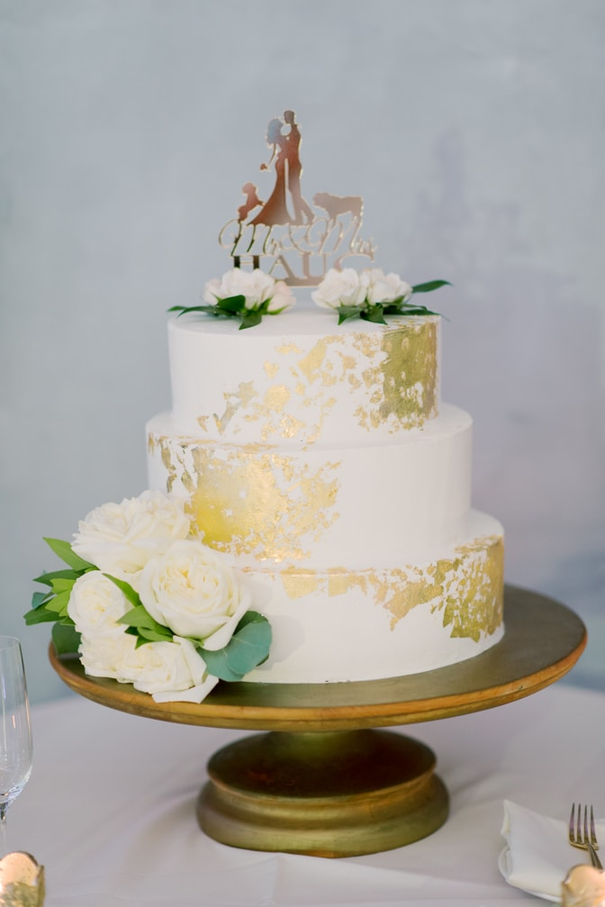 Wedding cake with gold foil elements at wedding reception at Larkspur events and dining in Vail