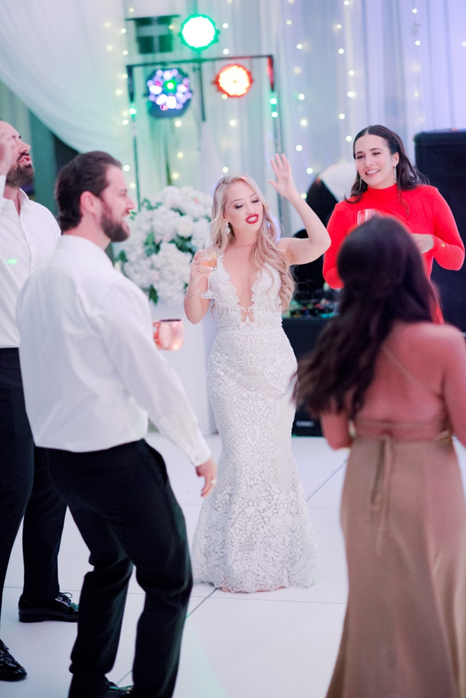 Wedding party dancing during Larkspur events and dining wedding reception in Vail