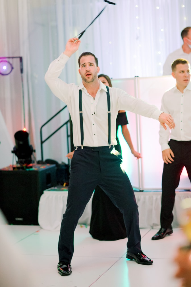 Groom dancing during his Larkspur events and dining wedding reception in Vail