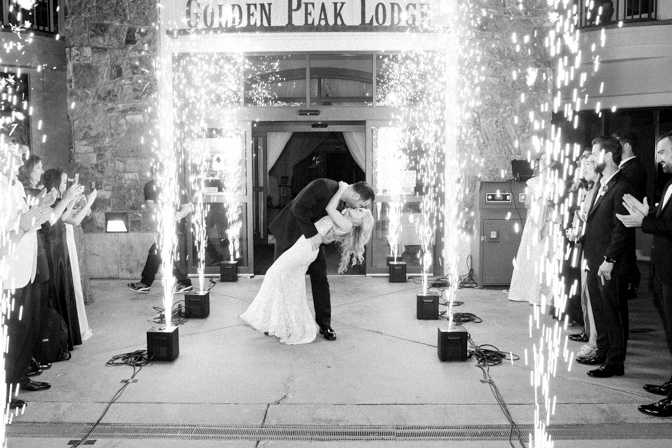 Bride and groom kissing each other during sparktacular cold sparks at Vail wedding reception