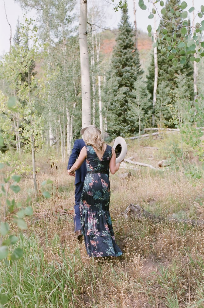 Bride and groom walking in a forest in Aspen during their Aspen engagement