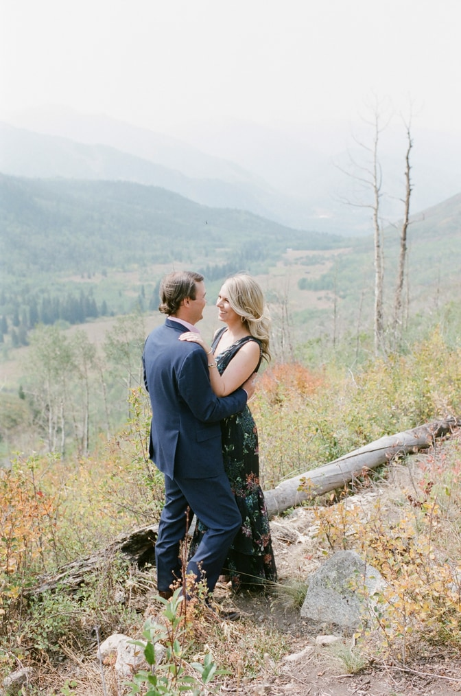 Bride and groom looking at each other on top of the mountain in Aspen