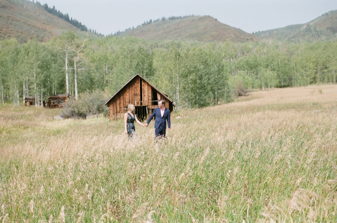 Bride and groom walking through a ghost town in Aspen