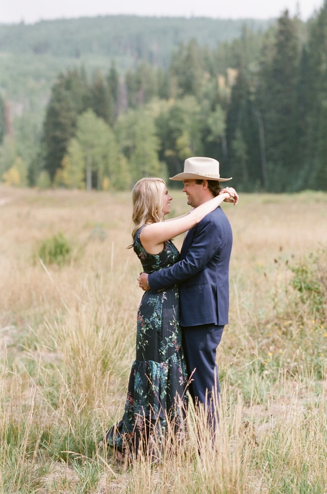 Bride and groom hugging each other during their Aspen fall engagement session