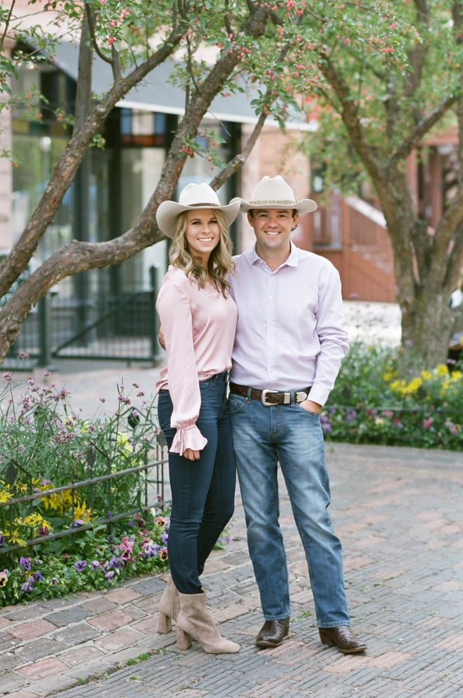 Bride and groom with cowboy hats during their Aspen fall engagement session