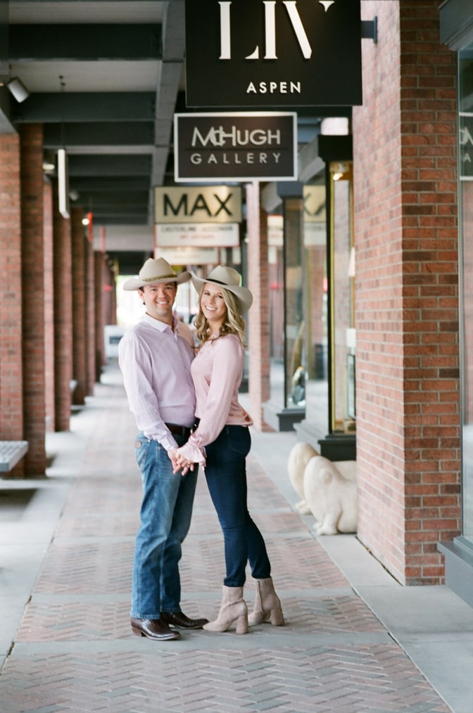Bride and groom standing in a shop alley in Aspen town