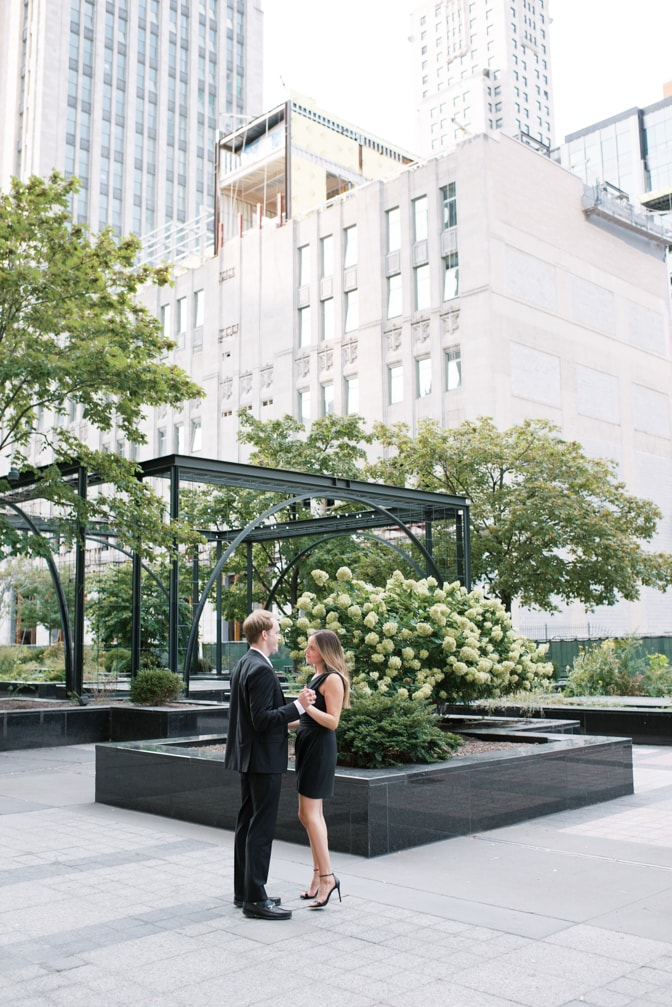Bride and groom looking at each other in front of Chicago Tribune building