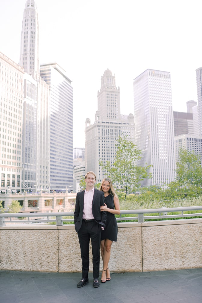Bride and groom standing next to each other in front of the Chicago River