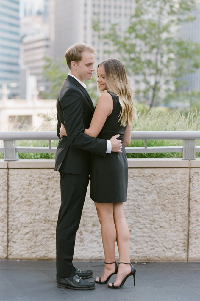 Bride and groom embracing each other during their Chicago fall engagement session