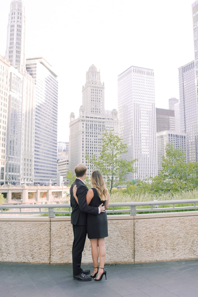 Bride and groom turning their back towards camera and enjoying Chicago downtown views