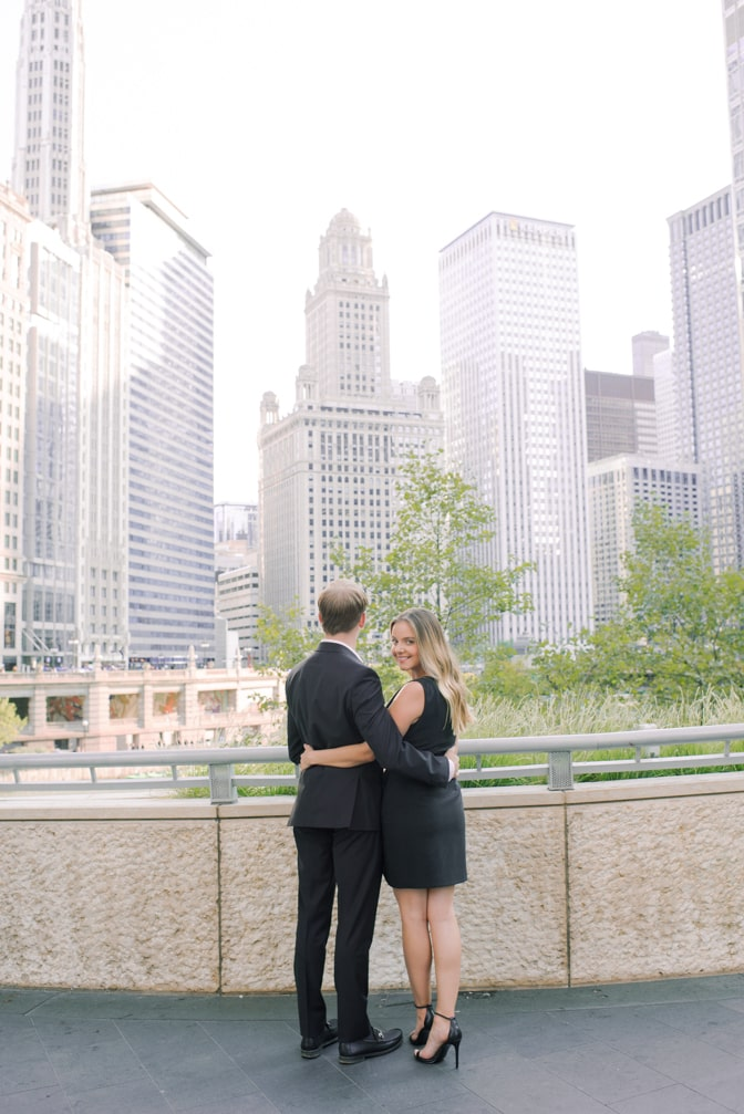 Bride and groom in front of the Chicago river during their Chicago engagement session