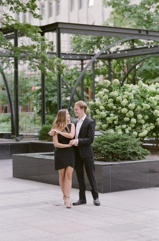 Bride and groom dancing in front of hydrangea in Chicago downtown