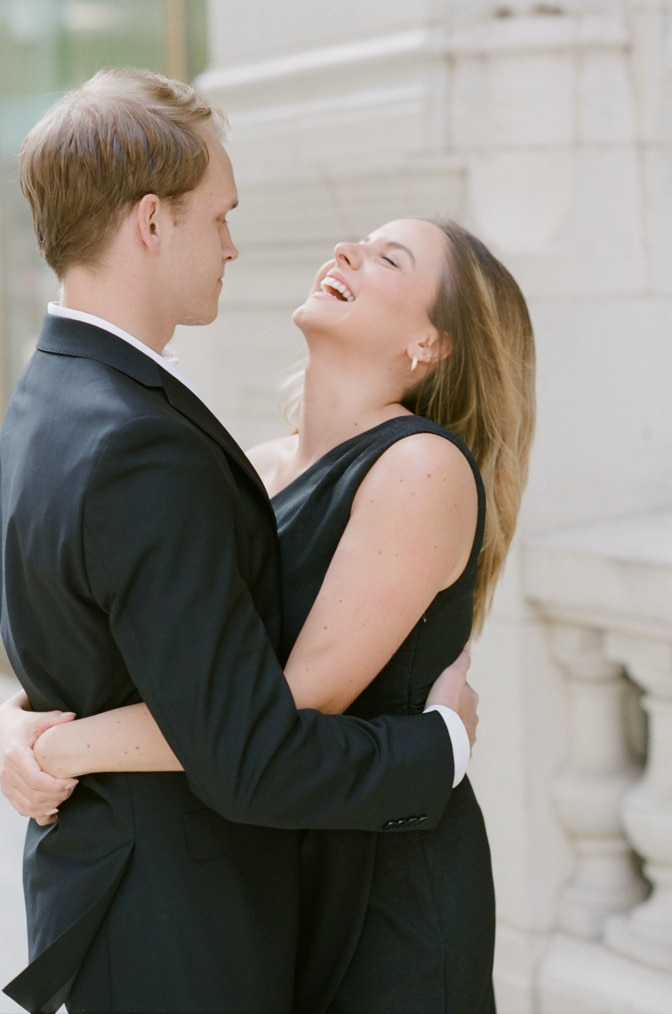 Bride laughing with groom during Chicago engagement session