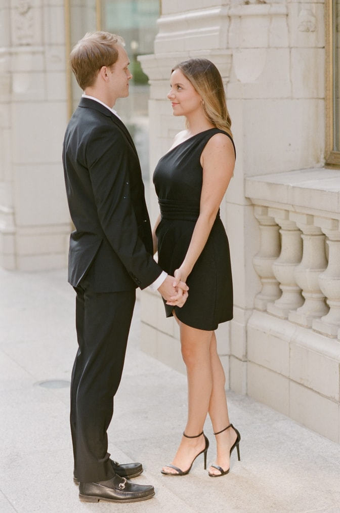 Bride and groom facing each other during their Chicago fall engagement