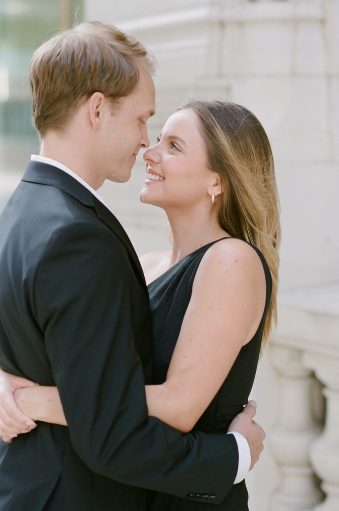 Bride and groom facing each other and touching noses during their Chicago engagement