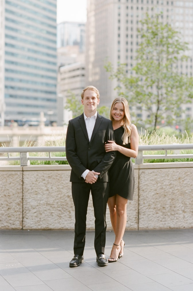 Bride and groom standing in front of camera during their Chicago fall engagement