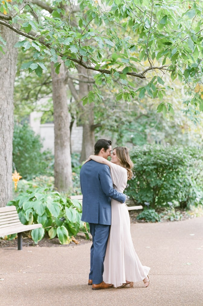 Bride and groom embracing each other at Sensory Garden in St Louis