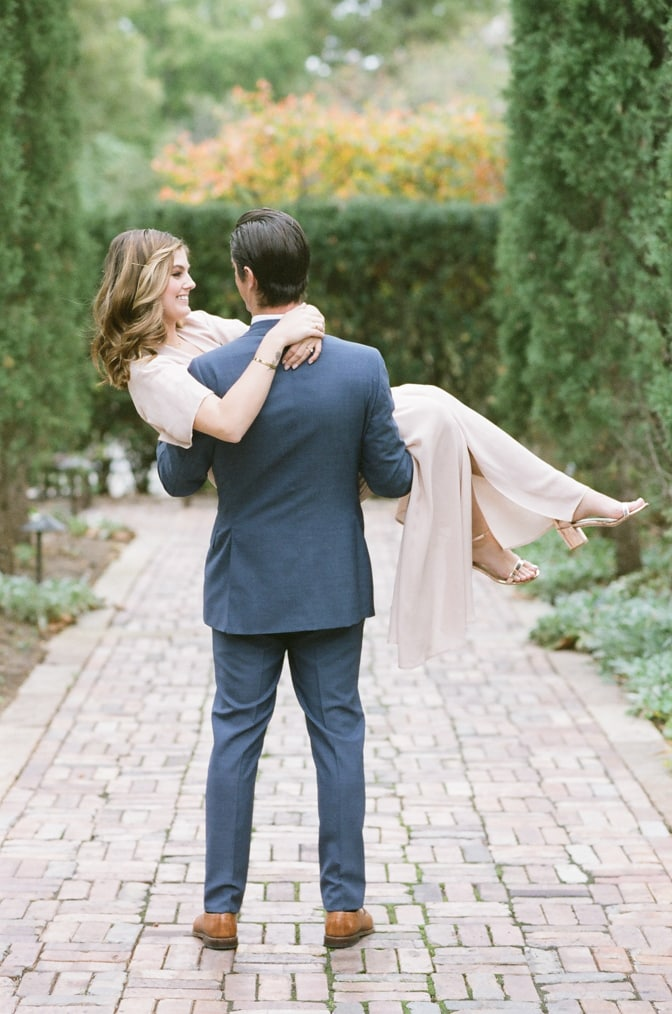 Groom lifting his bride amongst the cypresses of the Ottoman Garden in St Louis