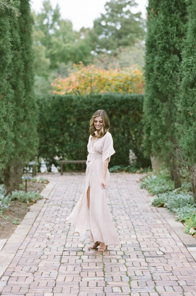 Bride to be dancing amongst an alley of cypresses at Ottoman garden in St Louis