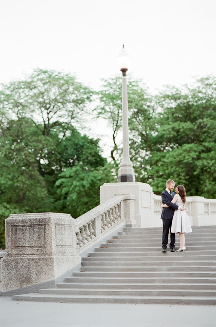 Bride and groom embracing each other on the steps of Grant Park in Chicago