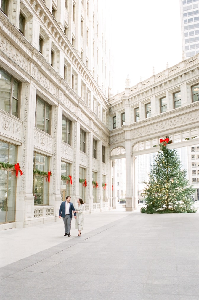 Bride and groom walking arm in arm at the courtyard of the Wrigley Building