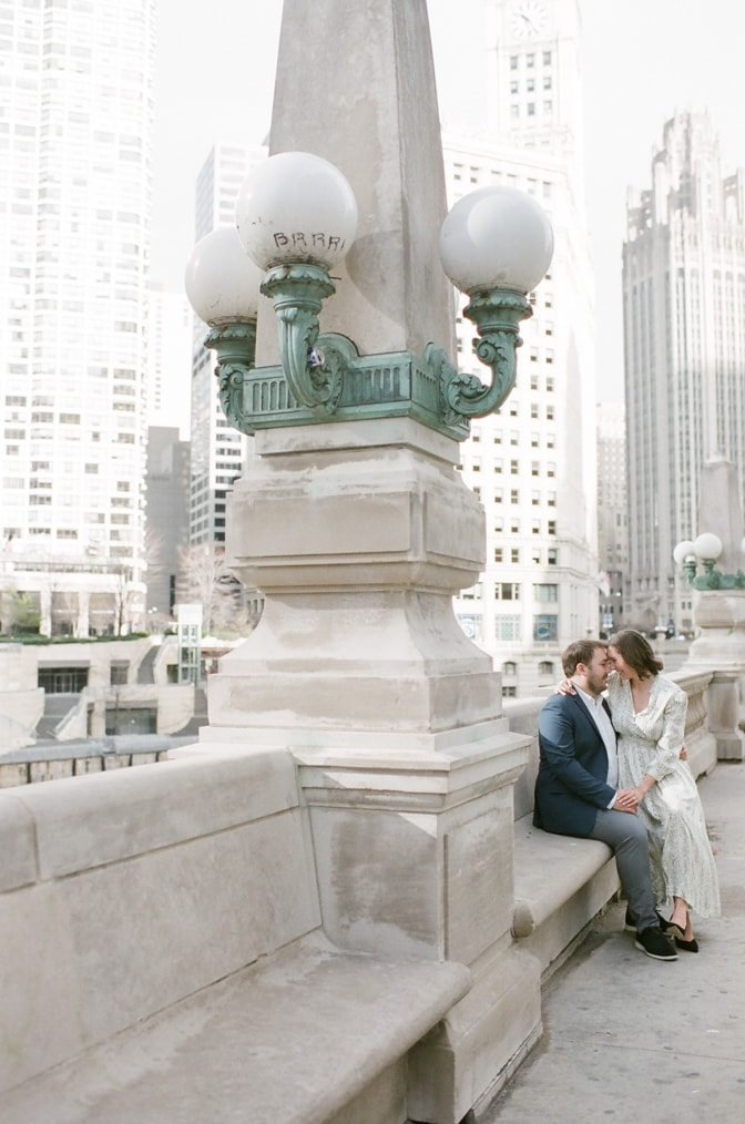 Bride sitting on the lap of her groom at the Chicago Riverwalk