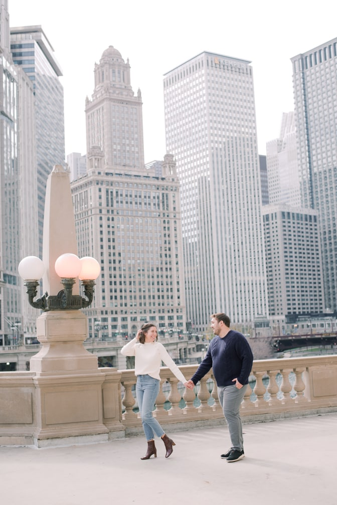 Chicago wedding photographer Tamara Gruner photographing engaged couple walking in front of Chicago city views