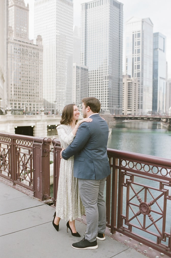 Bride and groom looking at each other on Michigan Ave bridge in Chicago