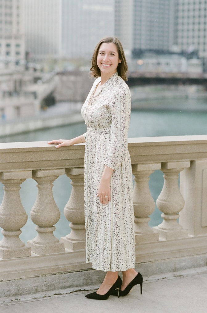 Bride wearing an ivory Maxi dress during her winter Chicago engagement