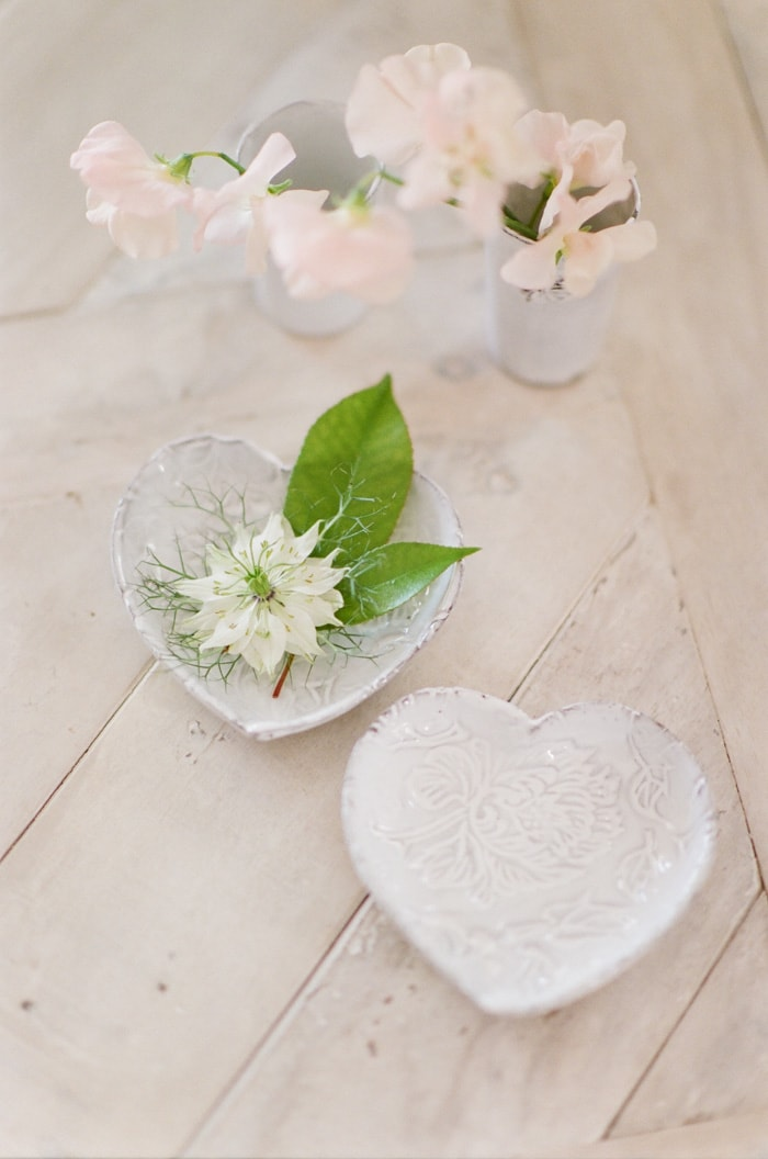 Florals placed in a heart ceramic bowl