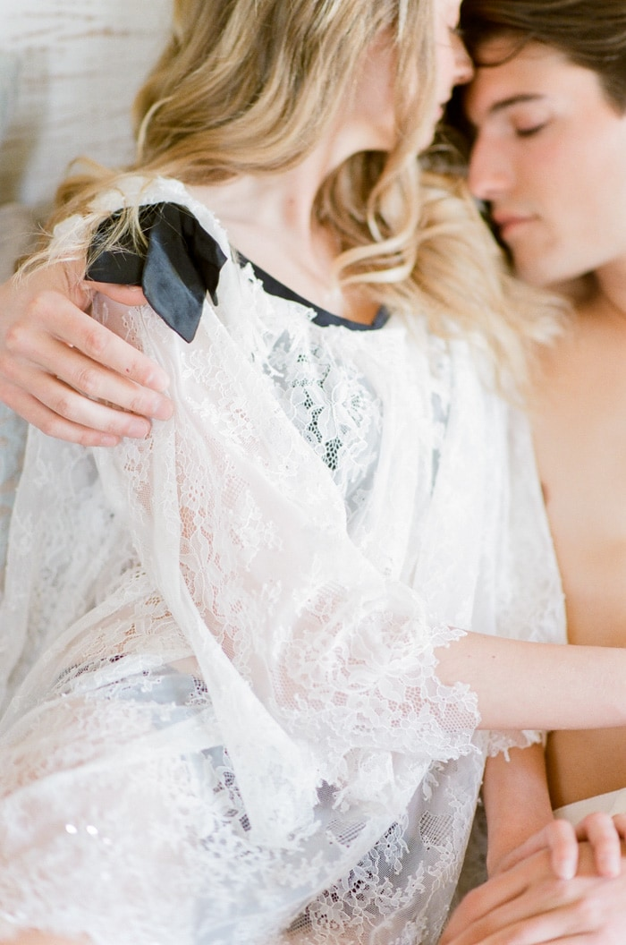 Bride and groom embracing each other during their Colorado boudoir session