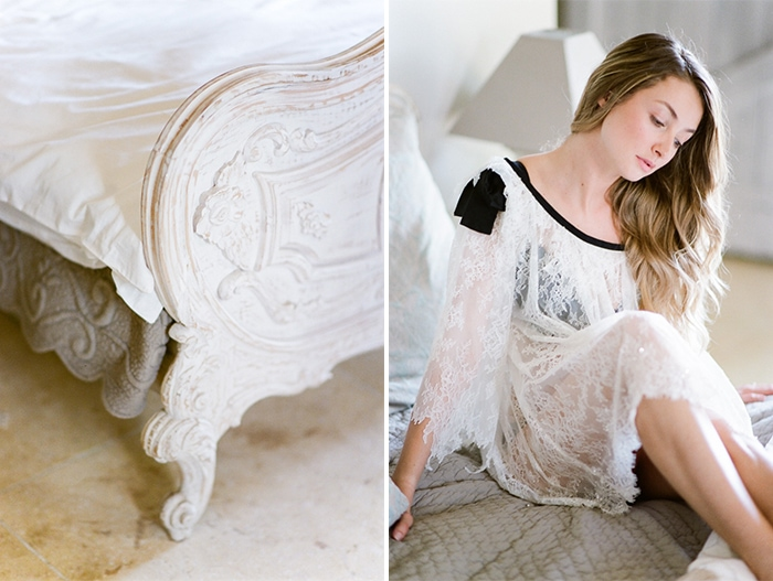 Bride to be sitting on top of the bed in her lace morning gown