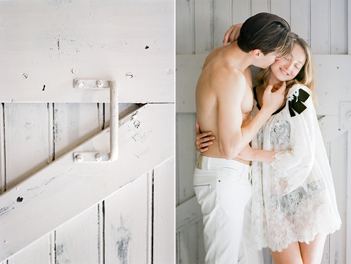 Bride and groom leaning on a white sliding door