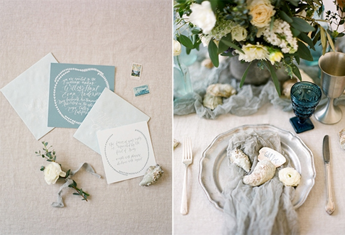 Closeup of a sea-themed wedding invitation suite