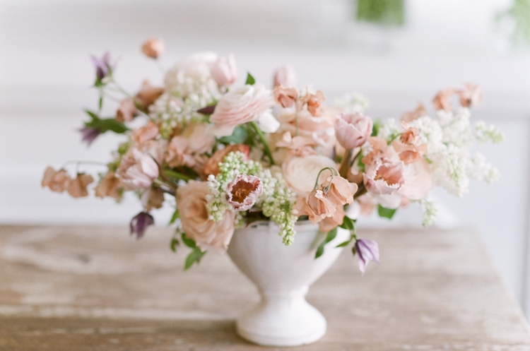 Floral centerpiece with blush and white blooms