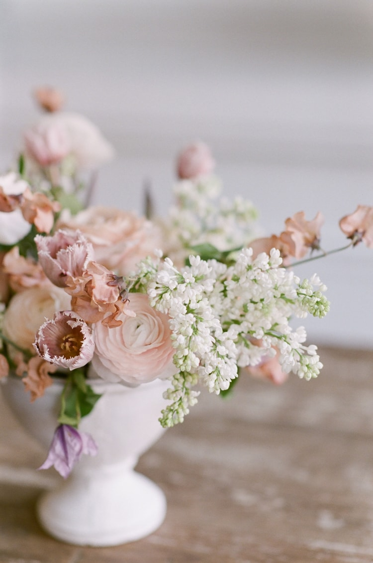 Wedding reception floral centerpiece with blush blooms