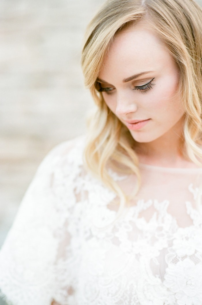 Closeup of bride in her lace Claire Pettibone wedding gown