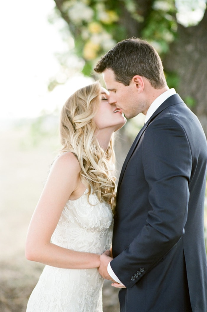 Bride and groom kissing each other during their Colorado elopement