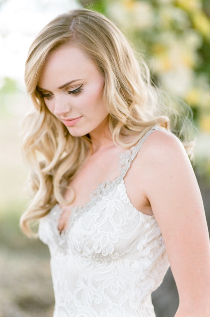 Closeup of bride in her Claire Pettibone lace wedding gown