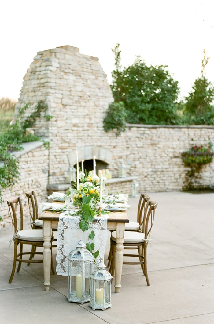 Sweetheart table adorned with green, white and yellow blooms