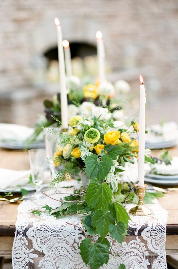 Closeup of a wedding flower centerpiece containing yellow, white and green flowers