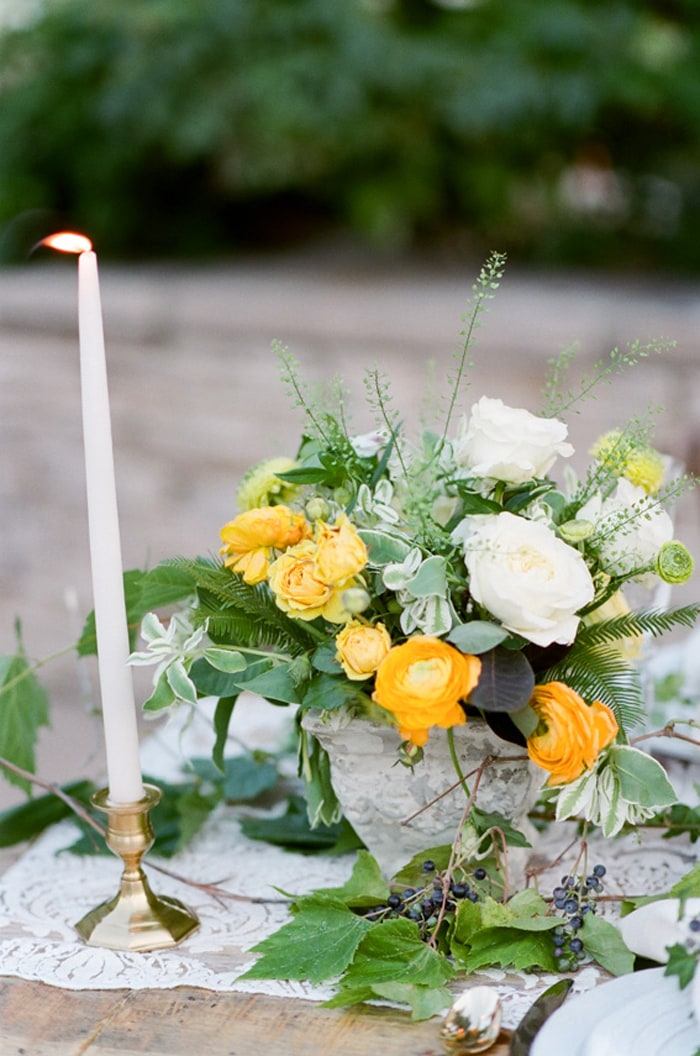 Yellow, white and green flower bouquet adorning a Colorado wedding sweetheart table